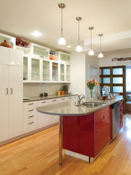 Silestone countertops grace the light-filled the kitchen.