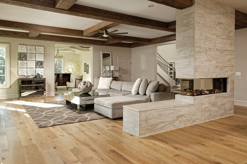 A frameless Lucius fireplace in a wall of porcelain tile separates the kitchen and the family room.