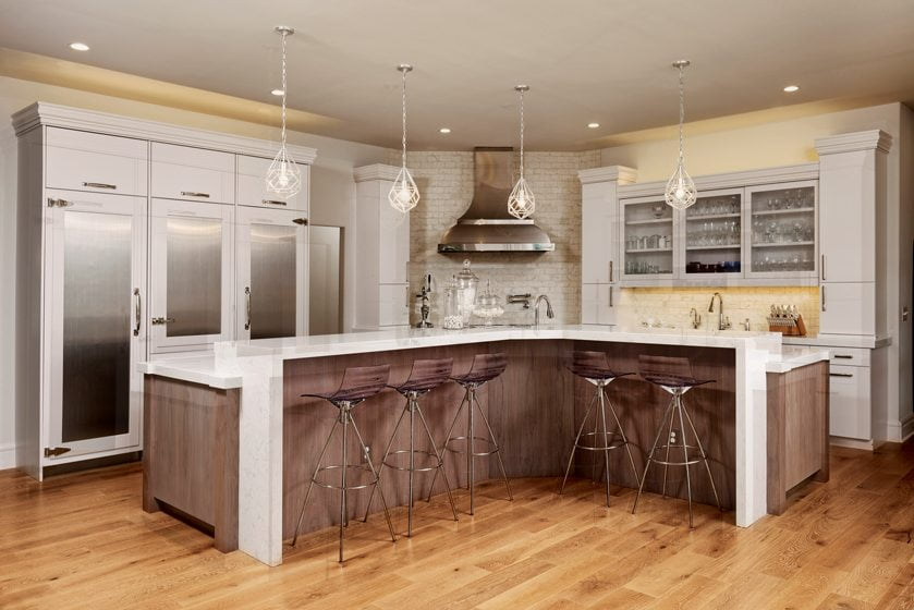Lisa Weiss selected finishes in the kitchen, where a refrigerator and freezer flank a central pantry.