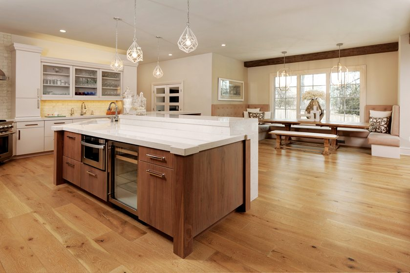 Peter Salerno Inc. crafted the cabinets in contrasting white lacquer and whitewashed butternut wood.