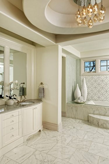 Lisa Weiss designed the master bath with a custom vanity, marble flooring and a Eurofase chandelier.