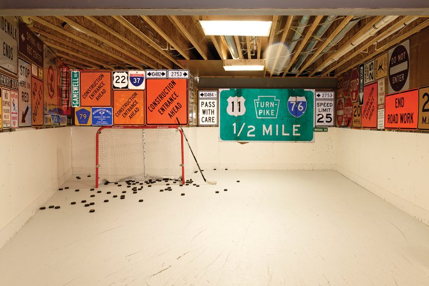 A room in the Weiss basement contains synthetic-ice flooring so son Christopher can practice shooting pucks.