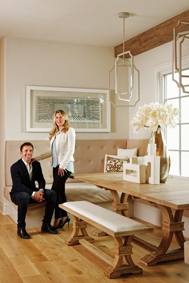 Michael and Lisa Weiss share a moment on the custom banquette in their breakfast room/kitchen.