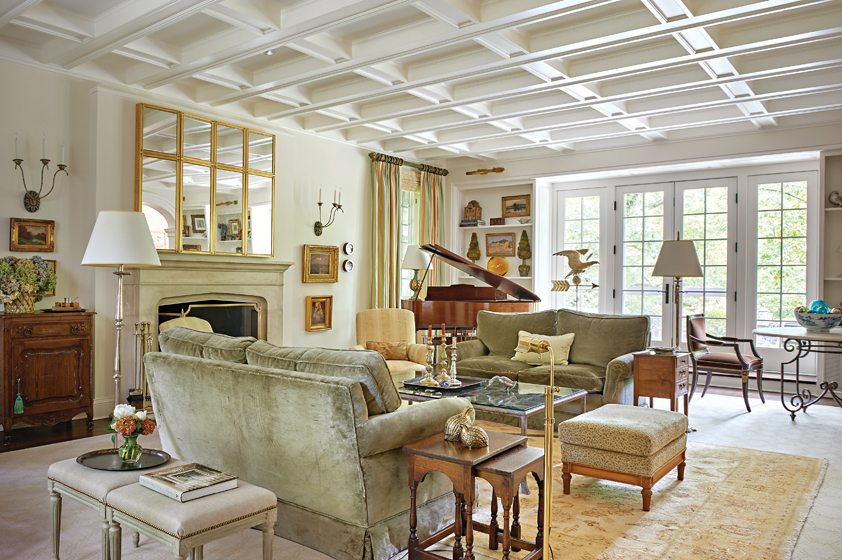 The large living room easily accommodates several seating areas and a grand piano.