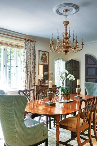 The dining room also leads outside through a Tudor-style arched door.