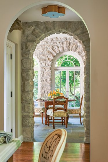 The breakfast room is distinguished by heated slate floors and whitewashed granite walls.