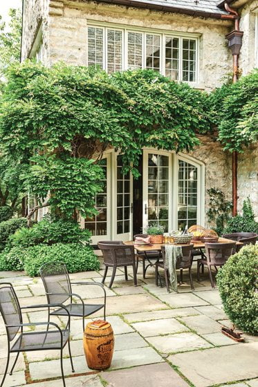 Designed by Green Gardens, Inc., the back patio offers space for al fresco dining.