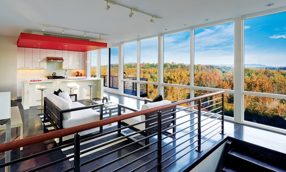 The open-plan living space places dramatic treetop views center stage.