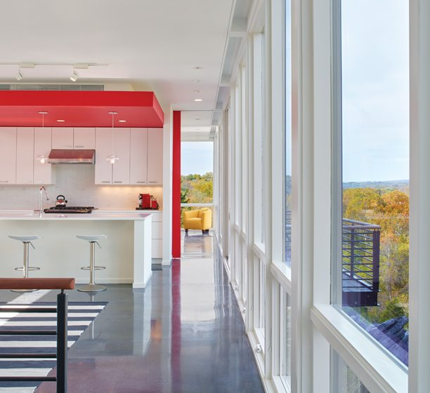 A red-painted pocket door closes off the passageway between the kitchen and the master bedroom.