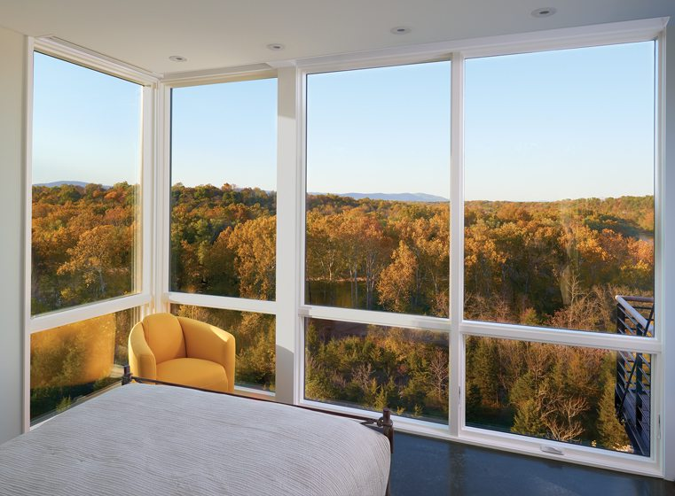 The master bedroom offers panoramic views through corner windows.
