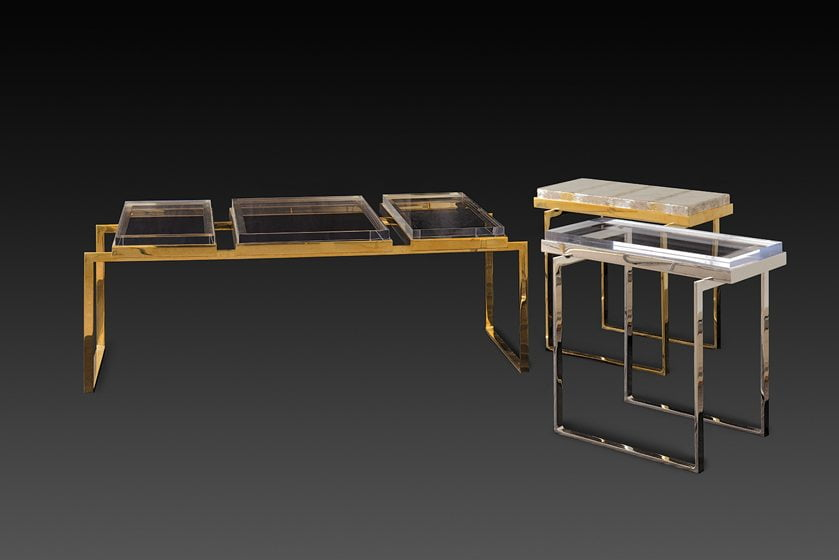 Tables designed by Gretchen Everett combine thick slabs of acrylic with custom metal frames.