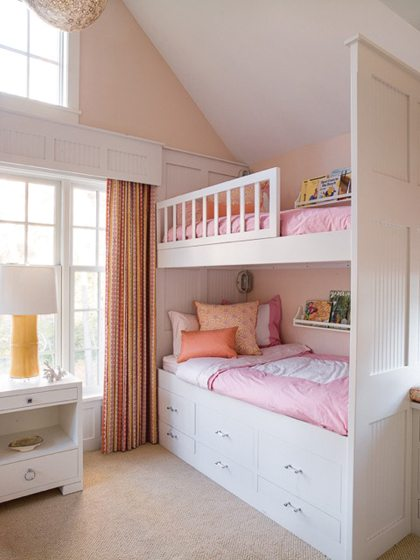 Everett's studio crafted the pillows and drapes in a child's bedroom by Liz Levin. © Helen Norman
