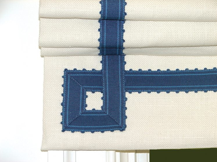 A hand-stitched Greek key pattern on a finished shade.
