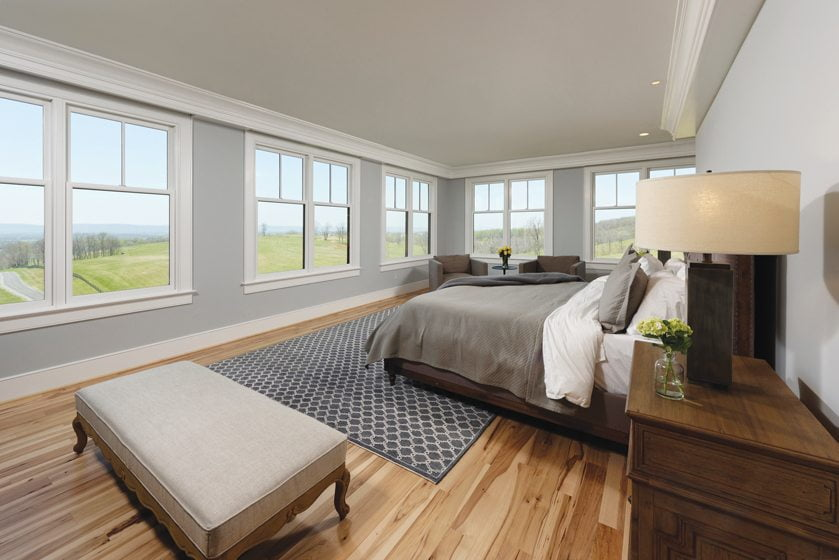 Automated shades in the top-floor master suite open to reveal 180-degree views.