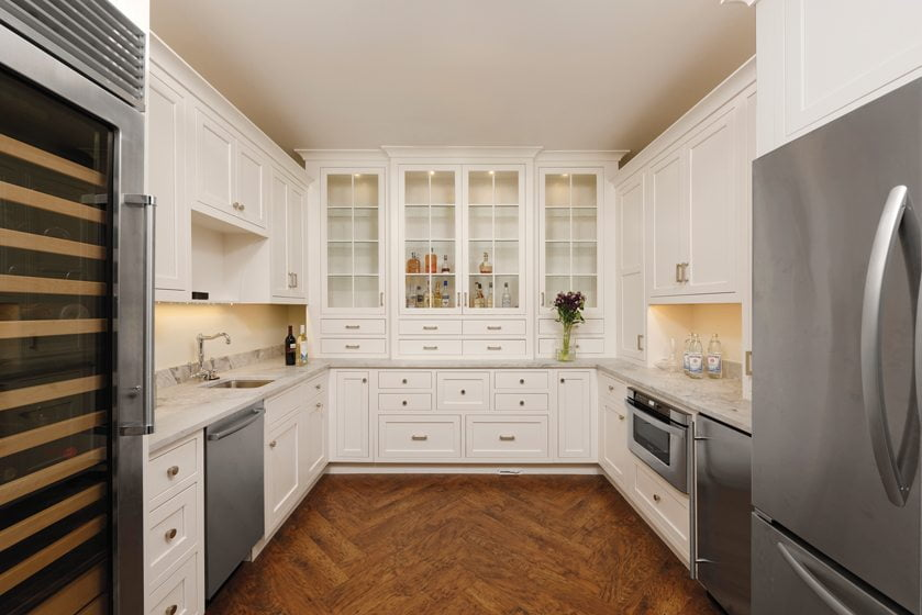 Facing the library, a secondary kitchen caters to crowds when the owners entertain.
