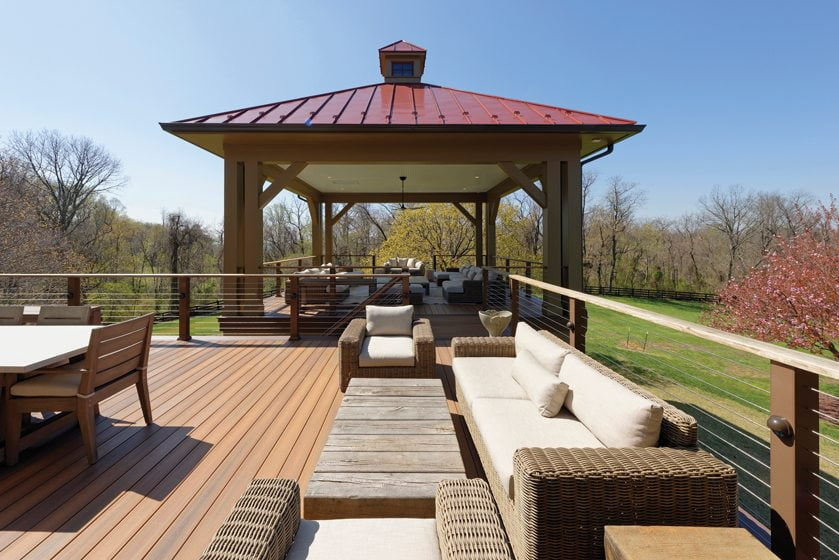 A new deck flows into a bi-level outdoor pavilion.