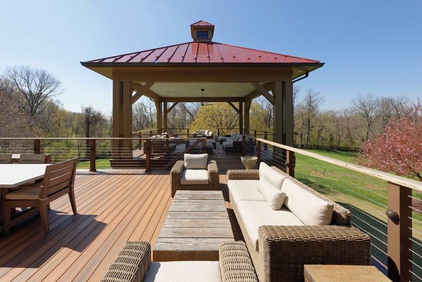 A new deck flows into a bi-level outdoor pavilion.
