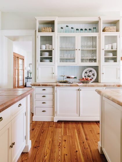 Benjamin Moore's Ocean Air refreshes the shelf backs on the kitchen's built-in hutch.