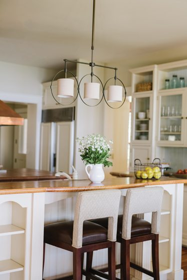 Bar stools from Fairfield Home and a new Gabby Home light fixture dress up the second island.