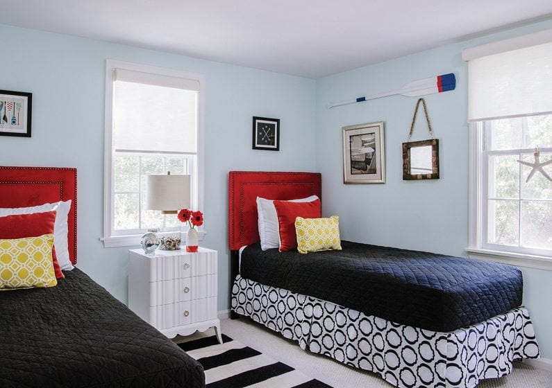 In a guest-cottage bedroom, a Bungalow 5 chest separates twin beds.