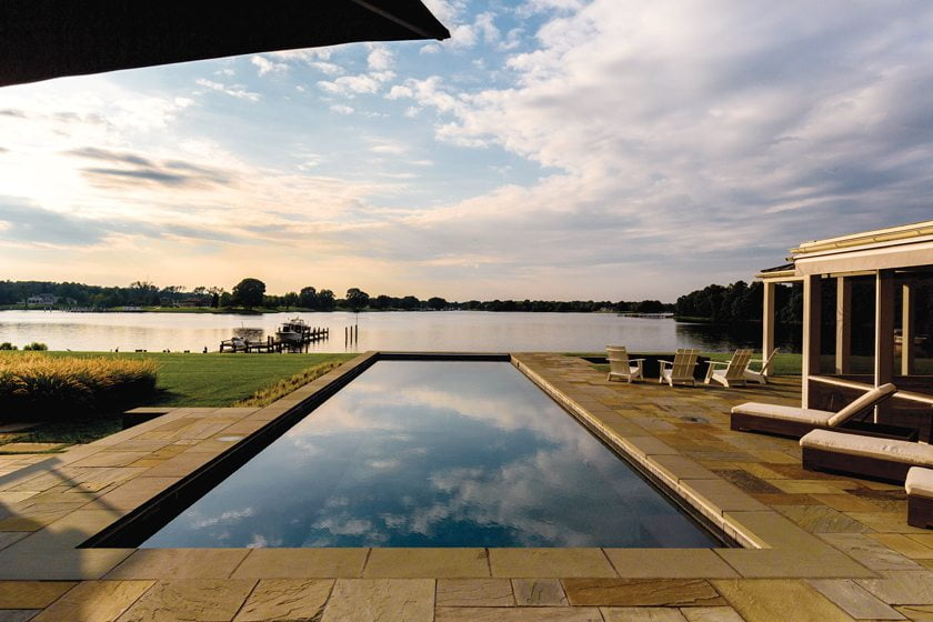 Full-range bluestone paving in shades of bronze, tan, blue and gray cover the pool terrace.