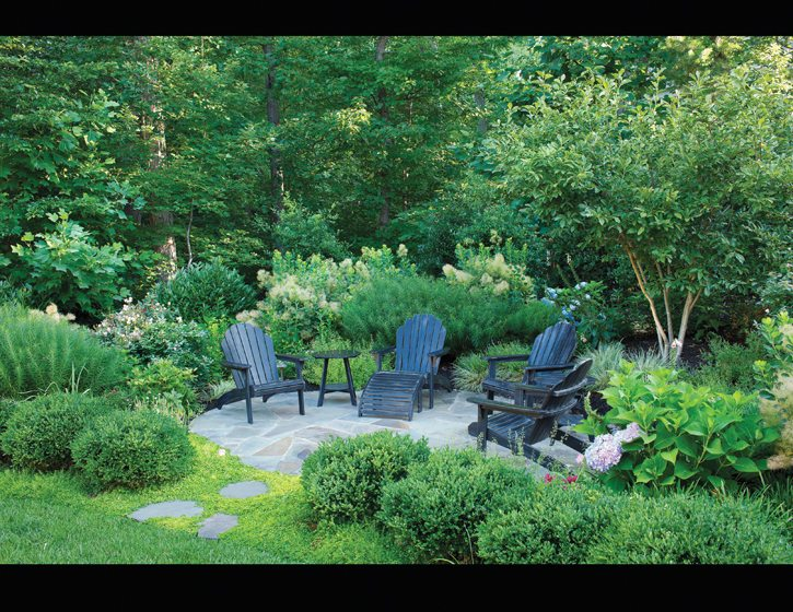 A secluded patio by Botanical Decorators displays visual and tactile interest. © Roger Foley