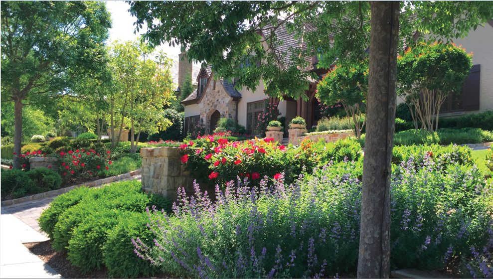 Boldly hued flowers are massed for greatest impact in the terraced front yard. © John Spaulding