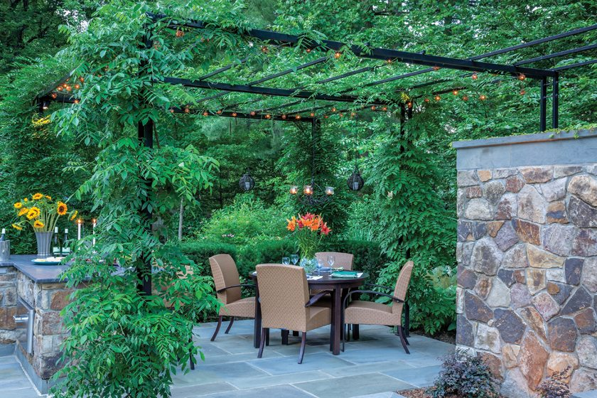 Al fresco dining in a McLean garden designed by Scott Brinitzer Design Associates. © Roger Foley