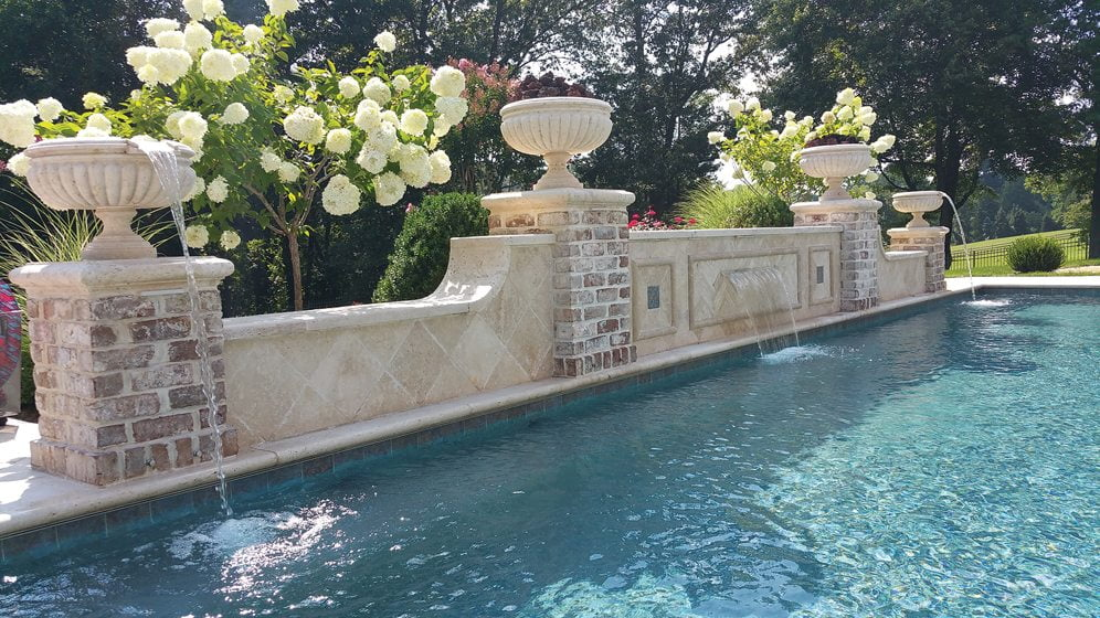 A poolside water feature by Outdoor Environments.