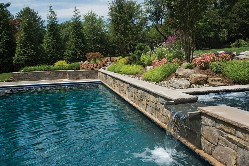 A spa and pool by Fine Earth Landscape, Inc.