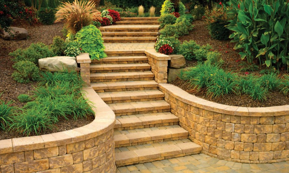 Pavers create retaining walls and stairs in a design by CLP, Scapes, Inc.