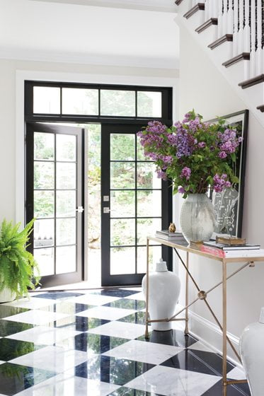 The black-and-white foyer provides drama and contrast.