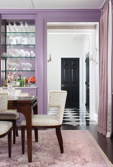 Benjamin Moore's Amorous covers the walls of the dining room.
