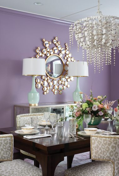 An Oly chandelier and Emporium Home mirror add glamour to the dining room.