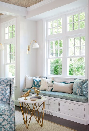 Window seats in the family room provide additional seating.