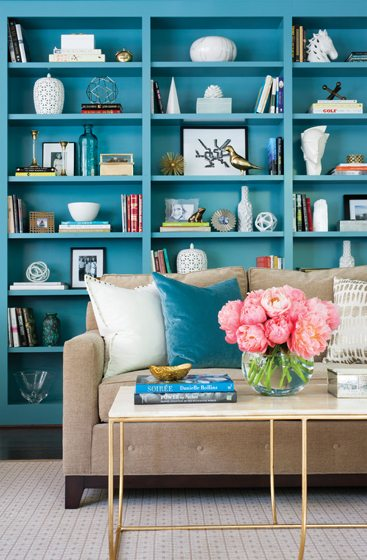 Built-in shelving is painted in Sherwin-Williams Cloudburst in the family room.