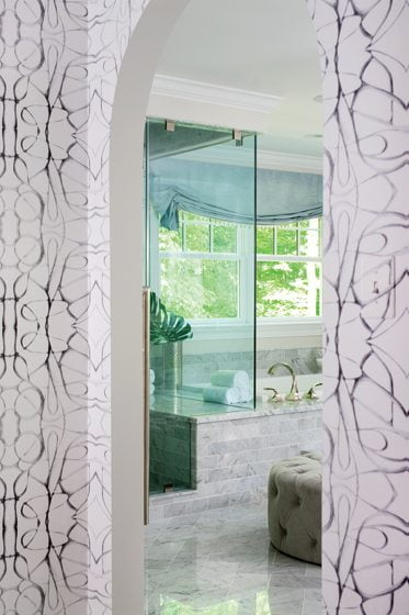 Abstract wallpaper by Lindsay Cowles delineates the entry to the master bath.