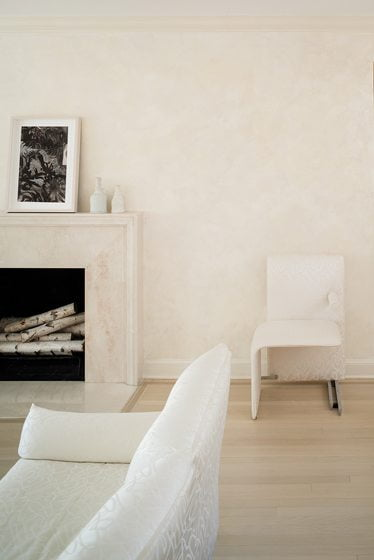 The living room features a marble mantel designed by Drysdale and a Venetian-plaster wall treatment by Tom Hickey.