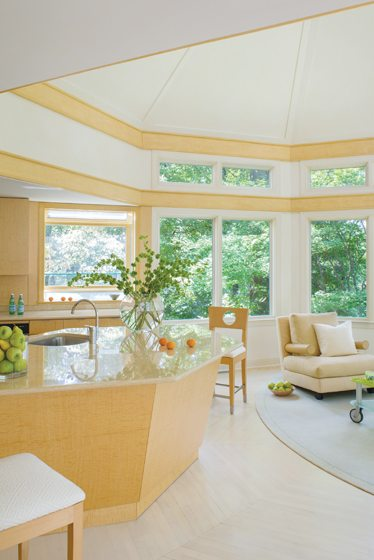Where necessary, damage to the kitchen was repaired with a faux bird's eye maple treatment.