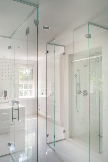 The wife's bath suite encompasses two rooms separated by a glassed-in shower and WC.
