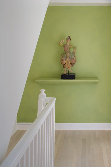 An accent wall of vivid green enlivens the original stairway.