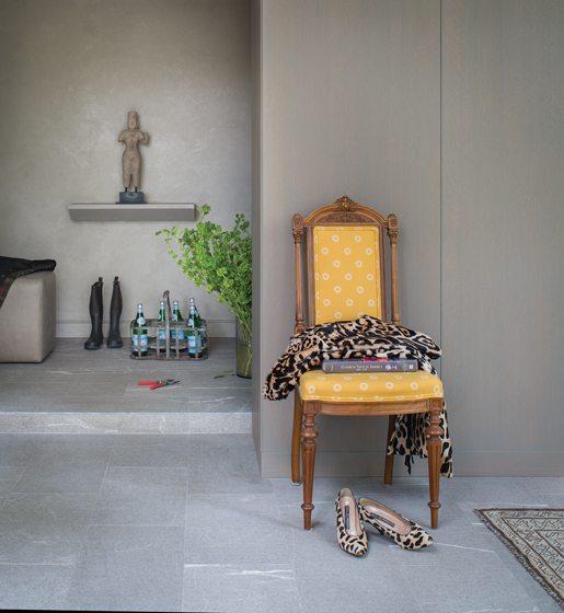 Honed-limestone floors and glazed-gray oak panels create a seamless effect.