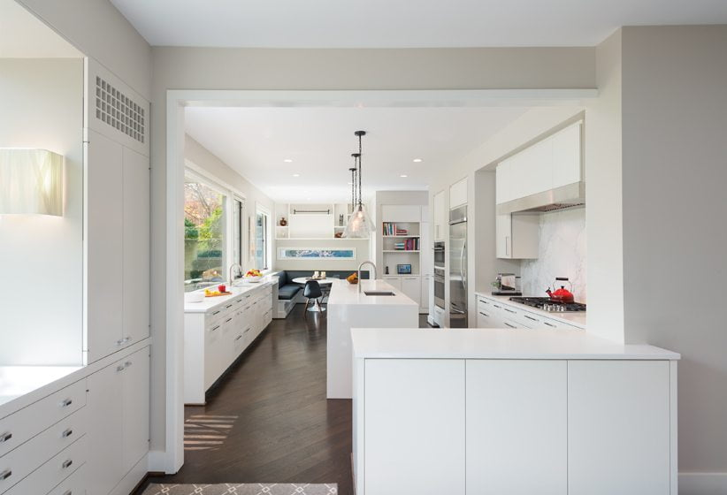 An island in the new kitchen anchors the work triangle on one side.