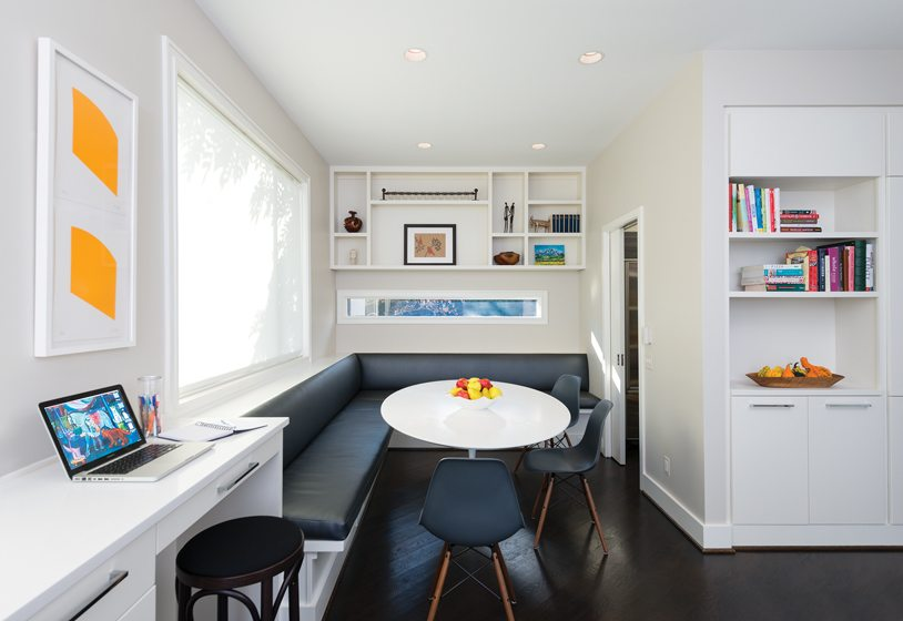 A breakfast nook contains a custom banquette.