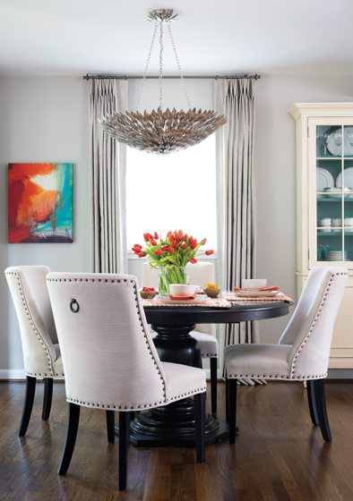 In the dining area, Carrington Court chairs surround the pedestal table.