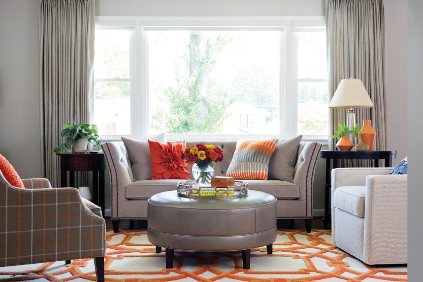 Throughout the main level, pops of color punctuate the soothing gray palette.