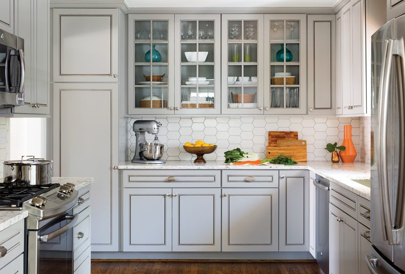 Cabinets by Kemper, quartz countertops and a ceramic-tile backsplash complete the kitchen.