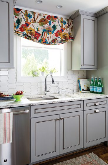 Over the Kohler sink, a custom window shade in Kravet fabric draws the eye.