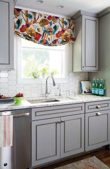 Over the Kohler sink, a custom window shade in Kravet fabric draws the eye.