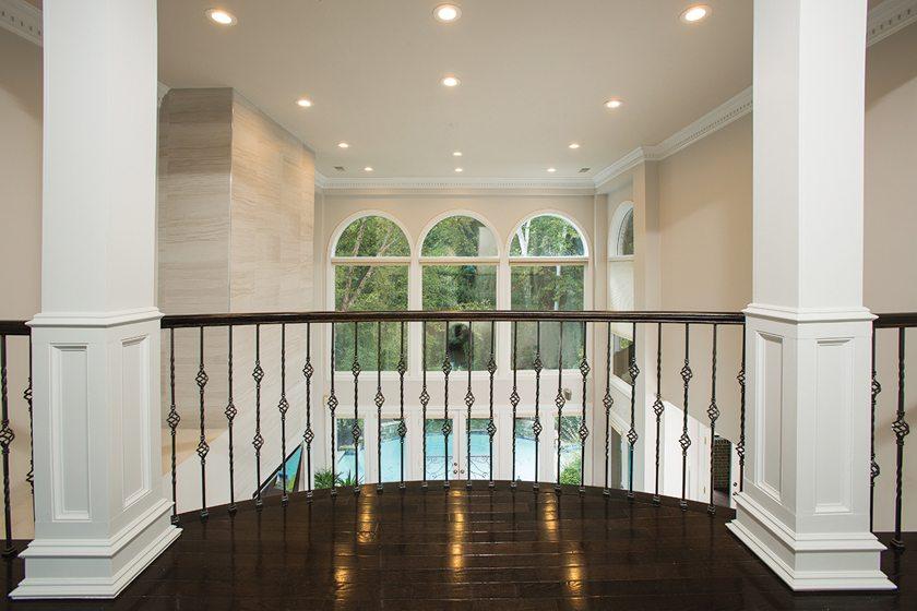 The upstairs hallway overlooks the family room.